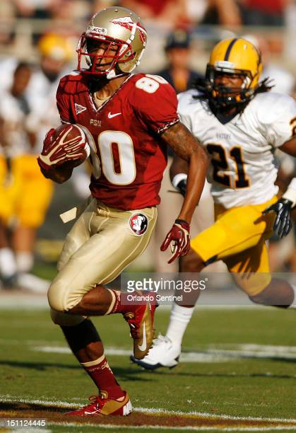 Florida State punt returner Rashad Greene runs a punt back for a touchdown against Murray State at Doak Campbell Stadium in Tallahassee Florida on...