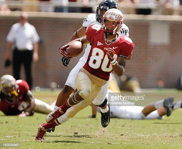 Florida State punt returner Rashad Greene runs back a punt for a 60yard touchdown against Wake Forest in the first quarter at Doak Campbell Stadium...