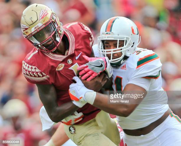 Florida State quarterback James Blackman is sacked by Miami defensive lineman Demetrius Jackson in the second quarter at Doak Campbell Stadium in...