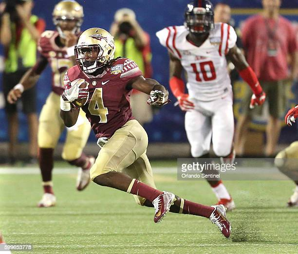 Florida State running back Dalvin Cook carries the ball during the Florida State vs University of Mississippi college football game on Monday Sept 5...