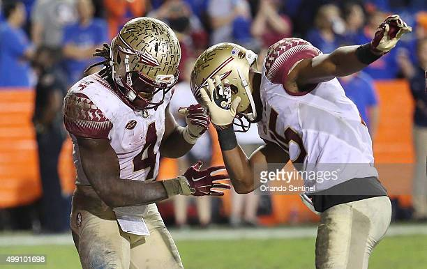 Florida State running back Dalvin Cook celebrates with wide receiver Travis Rudolph after Cook scored a fourthquarter touchdown against Florida at...