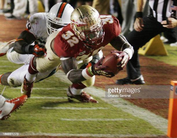 Florida State running back James Wilder Jr dives to complete a 5yard touchdown run in the third quarter against Miami at Doak Campbell Stadium in...
