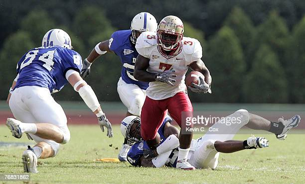 Florida State running back Leon Washington breaks a tackle by Duke's Glenn Williams and heads for Patrick Bailey during the Seminoles 5524 win...