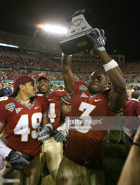 Florida State safety Myron Rolle holds up the Charles H Rohe Trophy following their 4213 victory over Wisconsin in the Champs Sports Bowl in Orlando...