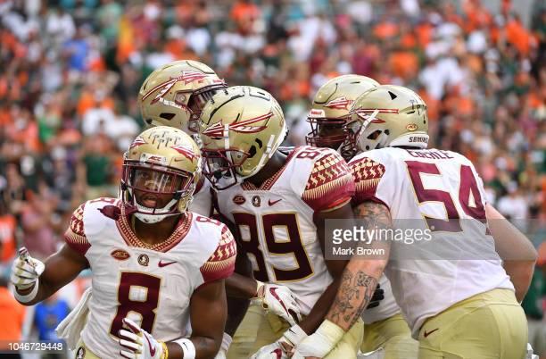 Florida State Seminoles celebrate a touchdown by Nyqwan Murray of the Florida State Seminoles in the first half against the Florida State Seminoles...