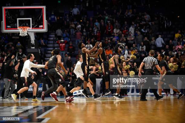 Florida State Seminoles celebrate the upset victory over seed Xavier Musketeers during the second half of the NCAA Division I Men's Championship...
