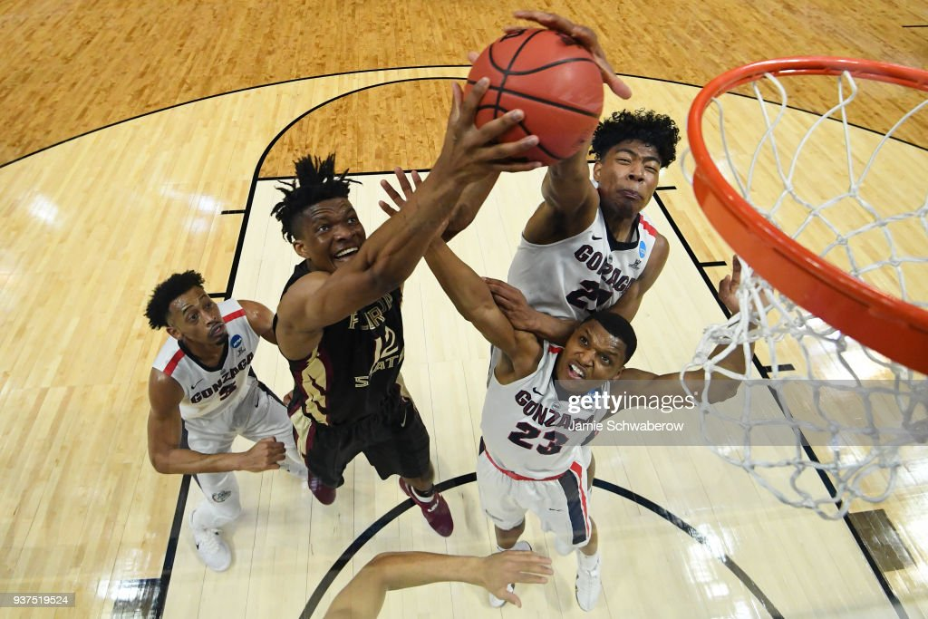 Florida State Seminoles center Ike Obiagu #12 goes up for the rebound in front of Gonzaga Bulldogs forward Rui Hachimura #21 during the third round of the 2018 NCAA Men's Basketball Tournament held at Staples Center on March 22, 2018 in Los Angeles, California.