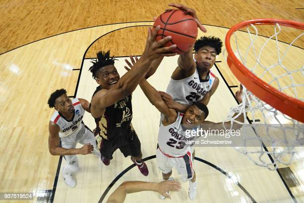 Florida State Seminoles center Ike Obiagu goes up for the rebound in front of Gonzaga Bulldogs forward Rui Hachimura during the third round of the...