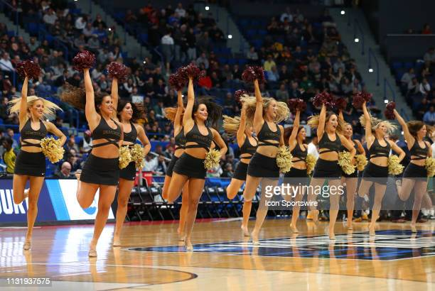 Florida State Seminoles cheerleaders perform during the basketball game between Vermont Catamounts and Florida State Seminoles on March 21 at XL...