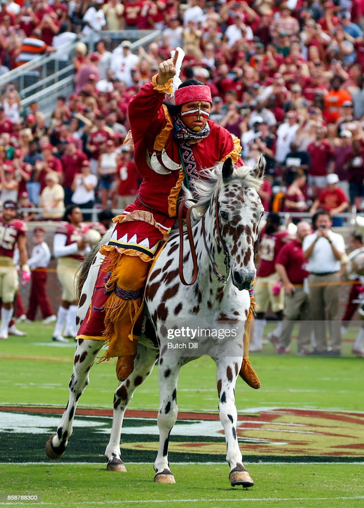 Florida State Seminoles Chief Osceola with his horse Renegade plants the spear before the start of of an NCAA football game against the Miami Hurricanes at Doak S. Campbell Stadium on October 7, 2017 in Tallahassee, Florida.