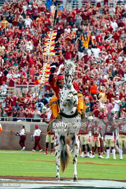 Florida State Seminoles Chief Osceola with his horse Renegade plants the spear before the start of of an NCAA football game against the Miami...