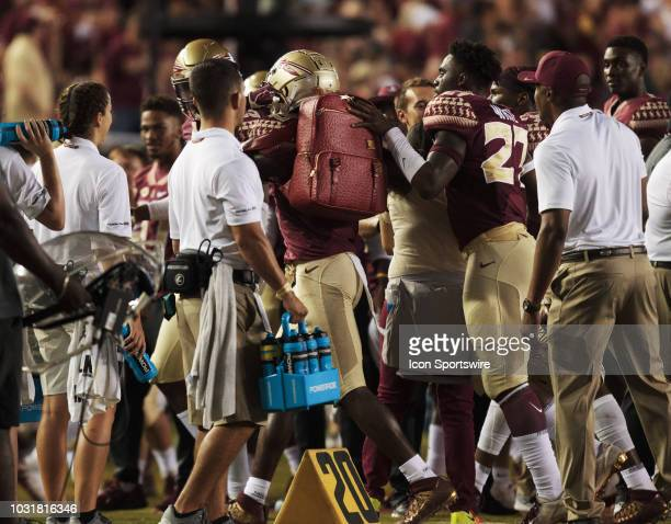 Florida State Seminoles defensive back AJ Westbrook wears a turnover backpack after an interception during the game between the Florida State...