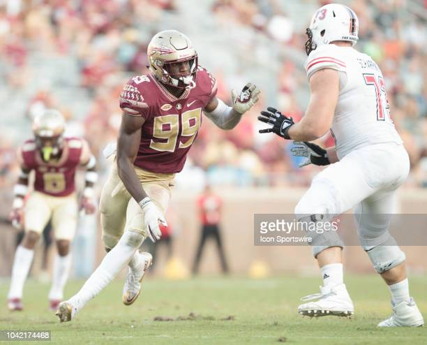 Florida State Seminoles defensive end Brian Burns evades blocker Northern Illinois Huskies offensive tackle Max Scharping during the game between the...