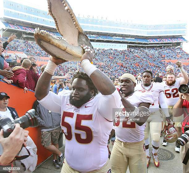 Florida State Seminoles defensive tackle Jacobbi McDaniel holds a gator head at the end of the game against the Florida Gators at Ben Hill Griffin...