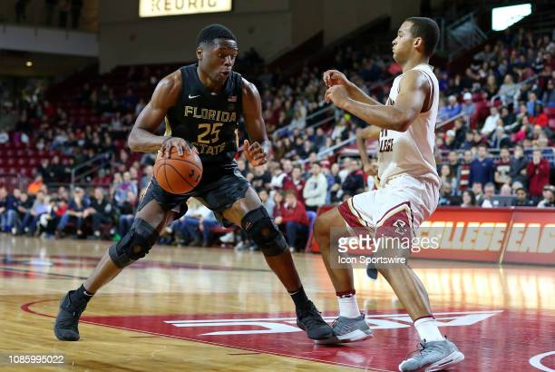Florida State Seminoles forward Mfiondu Kabengele and Boston College Eagles forward Steffon Mitchell in action during a college basketball game...