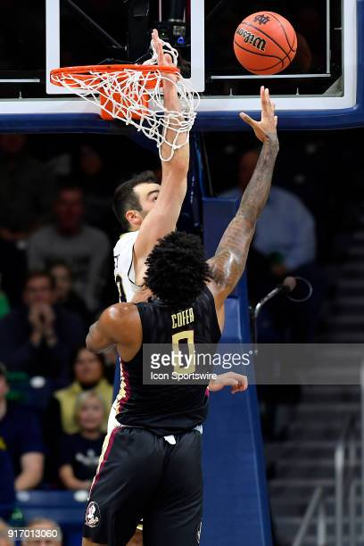 Florida State Seminoles forward Phil Cofer shot is interfered by Notre Dame Fighting Irish forward John Mooney during the game between the Notre Dame...