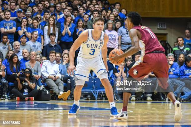Florida State Seminoles guard Braian Angola is defended by Duke Blue Devils guard Grayson Allen during the men's college basketball game between the...