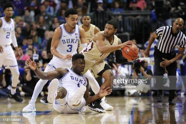 Florida State Seminoles guard David Nichols with the ball while Duke Blue Devils forward Zion Williamson and Duke Blue Devils guard Tre Jones try for...