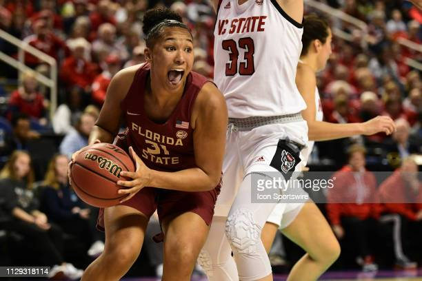 Florida State Seminoles guard Savannah Wilkinson drives the baseline during the ACC Women's basketball tournament between the NC State Wolfpack and...