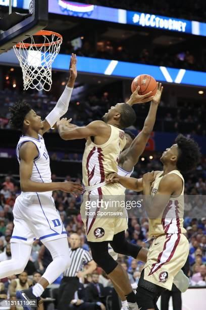 Florida State Seminoles guard Trent Forrest goes for the dunk during the 2nd half the of the ACC Tournament championship game with the Duke Blue...
