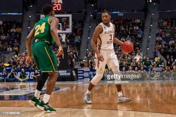 Florida State Seminoles guard Trent Forrest sets the play during the second half of the NCAA Division I Men's Championship first round college...
