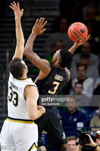 Florida State Seminoles guard Trent Forrest shoots over Notre Dame Fighting Irish forward John Mooney during the game between the Notre Dame Fighting...