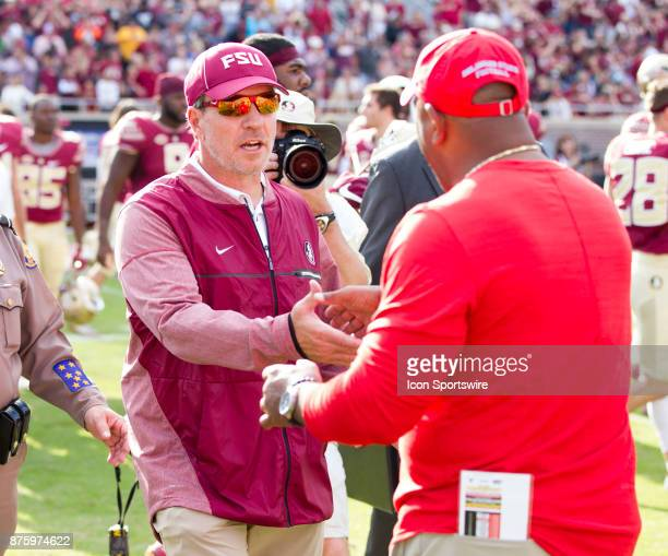 Florida State Seminoles head coach Jimbo Fisher shakes hands with Delaware State Hornets head coach Kenny Carter after the game between the Delaware...
