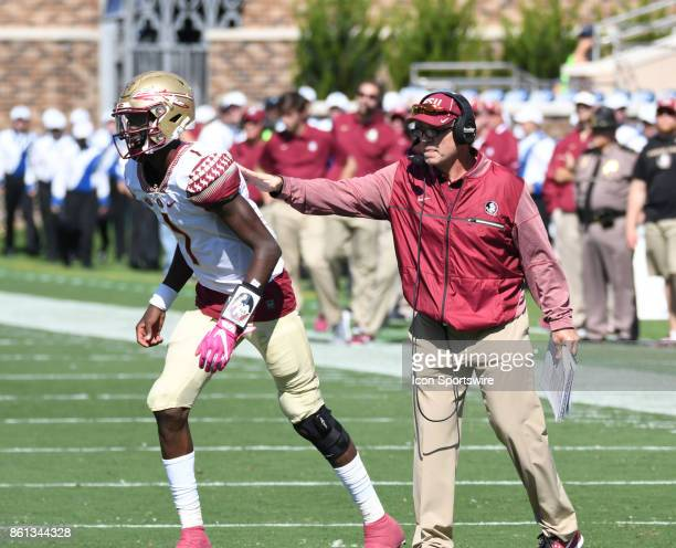 Florida State Seminoles head coach Jimbo Fisher with encouragement to Florida State Seminoles quarterback James Blackman during a college football...