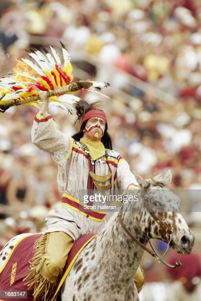 Florida State Seminoles' mascot Chief Osceola rides his Appaloosa Renegade before planting the flaming spear before the NCAA football game against...