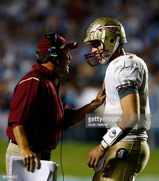 Florida State Seminoles Offensive Coordinator Jimbo Fisher speaks with his quarterback Christian Ponder during their game against the North Carolina...
