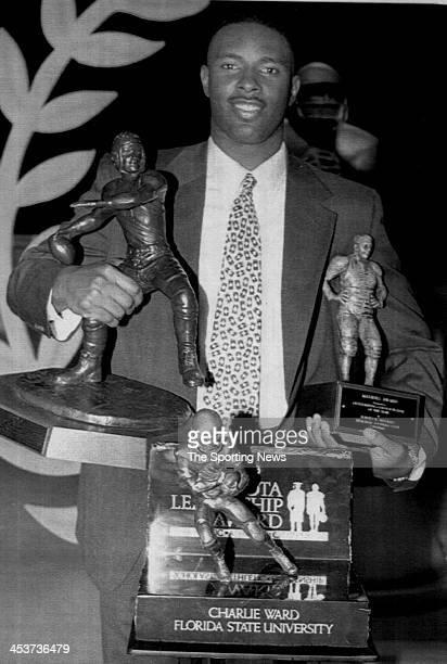 Florida State Seminoles quarterback Charlie Ward poses with his awards including Davey O'Brien Award Toyota Leadership Award and the Maxwell Award on...