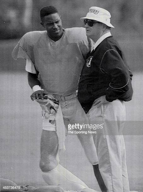 Florida State Seminoles quarterback Charlie Ward talks with head coach Bobby Bowden prior to the start of practice Sunday at the University of Miami...