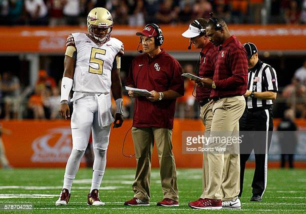 Florida State Seminoles quarterback Jameis Winston and Florida State Seminoles head coach Jimbo Fisher during a NCAA football game between the...