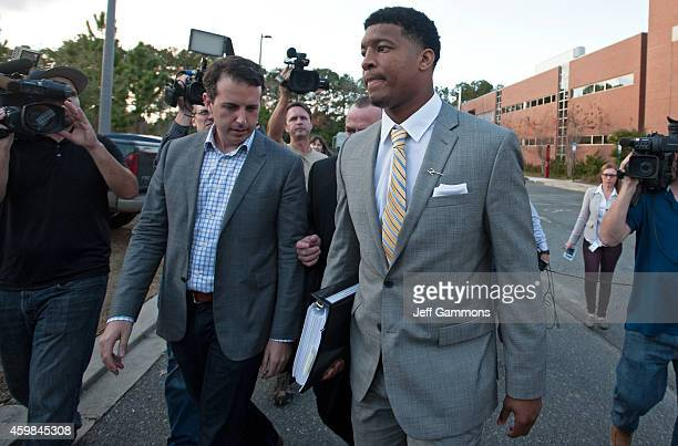 Florida State Seminoles quaterback Jameis Winston leaves his student conduct code hearing on December 2 2014 in Tallahassee Florida The hearing will...