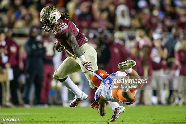 Florida State Seminoles running back Dalvin Cook runs for a gain past Florida Gators defensive back Teez Tabor during the NCAA football game between...
