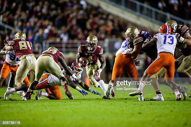 Florida State Seminoles running back Dalvin Cook runs for a gain during the NCAA football game between the Florida Gators and the Florida State...