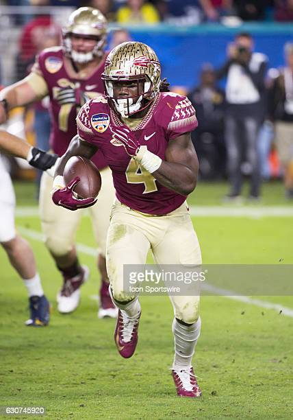 Florida State Seminoles Running Back Dalvin Cook runs with ball during the NCAA Capital One Orange Bowl football game between the Michigan Wolverines...