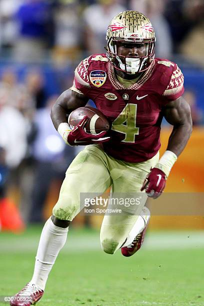 Florida State Seminoles running back Dalvin Cook rushes for yardage during the fourth quarter against the Michigan Wolverines in the Orange Bowl on...
