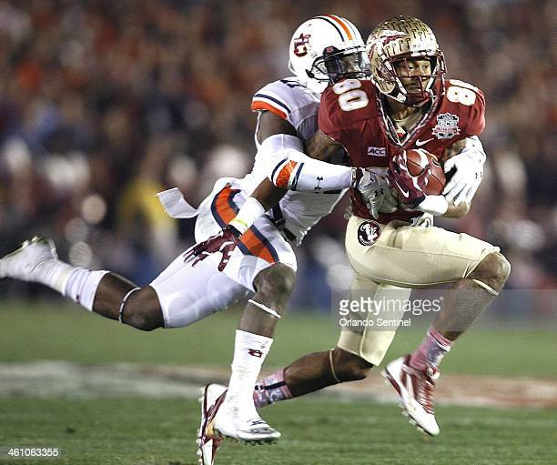 Florida State Seminoles wide receiver Rashad Greene makes a catch against Auburn Tigers cornerback Chris Davis during the BCS National Championship...