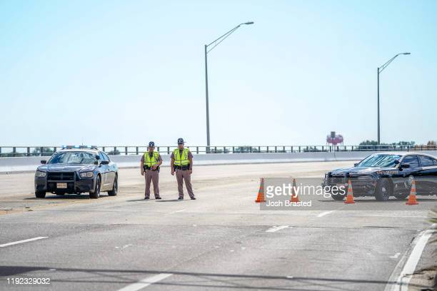 Florida State Troopers block traffic over the Bayou Grande Bridge leading to the Pensacola Naval Air Station following a shooting on December 06 2019...