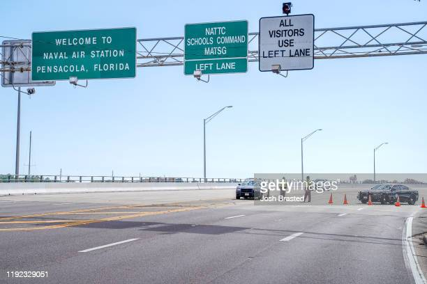 Florida State Troopers block traffic over the Bayou Grande Bridge leading to the Pensacola Naval Air Station following a shooting on December 06,...
