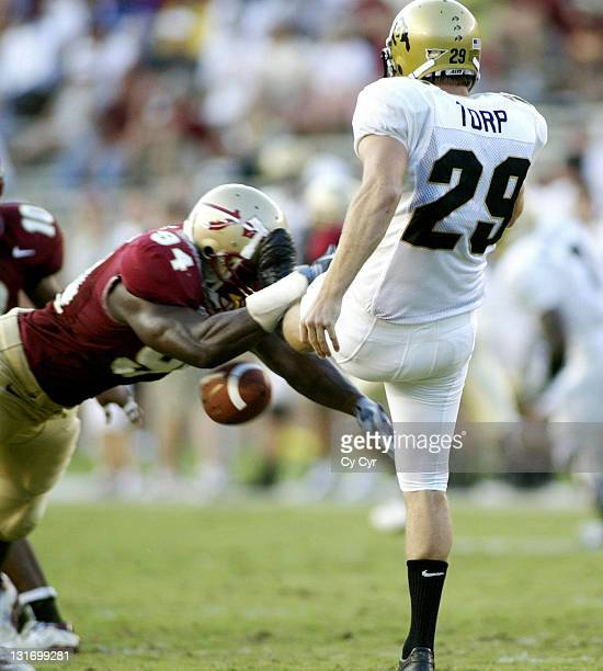Florida State University defensive end Chauncey Davis, #94, blocks a punt by kicker John Torp, then ran the ball in for a touchdown against Colorado...