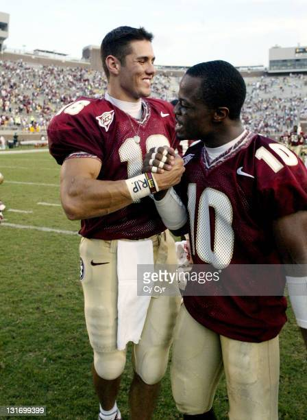 Florida State University quarterback Chris Rix, #16, is congratulated by teammate Stanford Samuels, #10, after beating Colorado University at Doak...