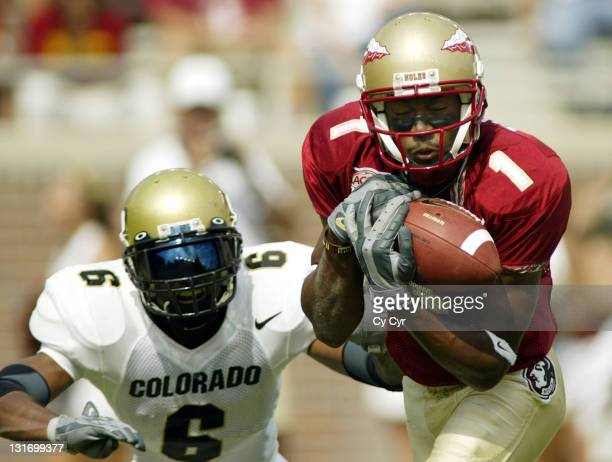 Florida State University wide receiver Craphonso Thorpe, #1, makes a catch for a touchdown with coverage by Colorado University's Phil Jackson, #6,...