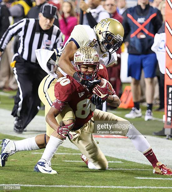 Florida State wide receiver Rashad Greene catches a pass under Georgia Tech cornerback Louis Young in the ACC Championship game at Bank of American...