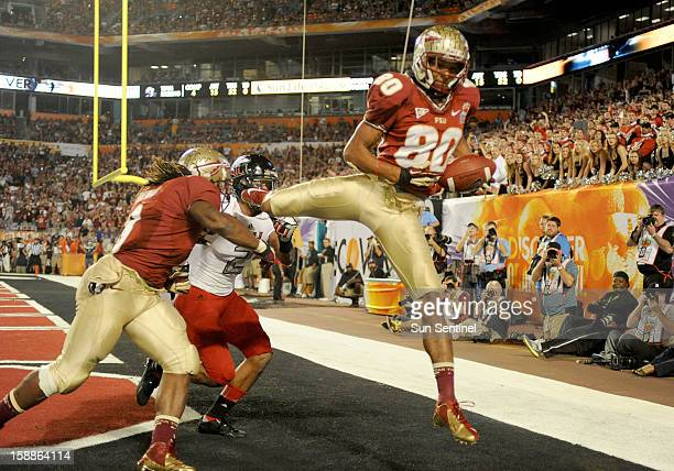 Florida State wide receiver Rashad Greene catches a touchdown pass against Northern Illinois during the first half of the Discover Orange Bowl on...