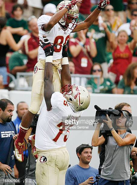 Florida State wide receiver Rashad Greene celebrates after a touchdown with offensive lineman Cameron Erving against South Florida at Raymond James...
