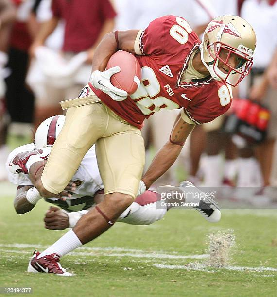 Florida State wide receiver Rashad Greene drags LouisianaMonroe cornerback Vincent Eddie behind him as Greene runs for a touchdown after a catch at...