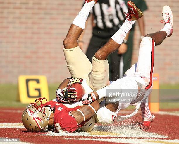 Florida State wide receiver Rashad Greene hangs on for a 42yard touchdown catch in the first quarter against North Carolina State at Doak Campbell...