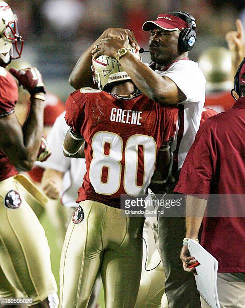 Florida State wide receiver Rashad Greene is congratulated by a coach after a catch against Clemson at Doak Campbell Stadium in Tallahassee Florida...